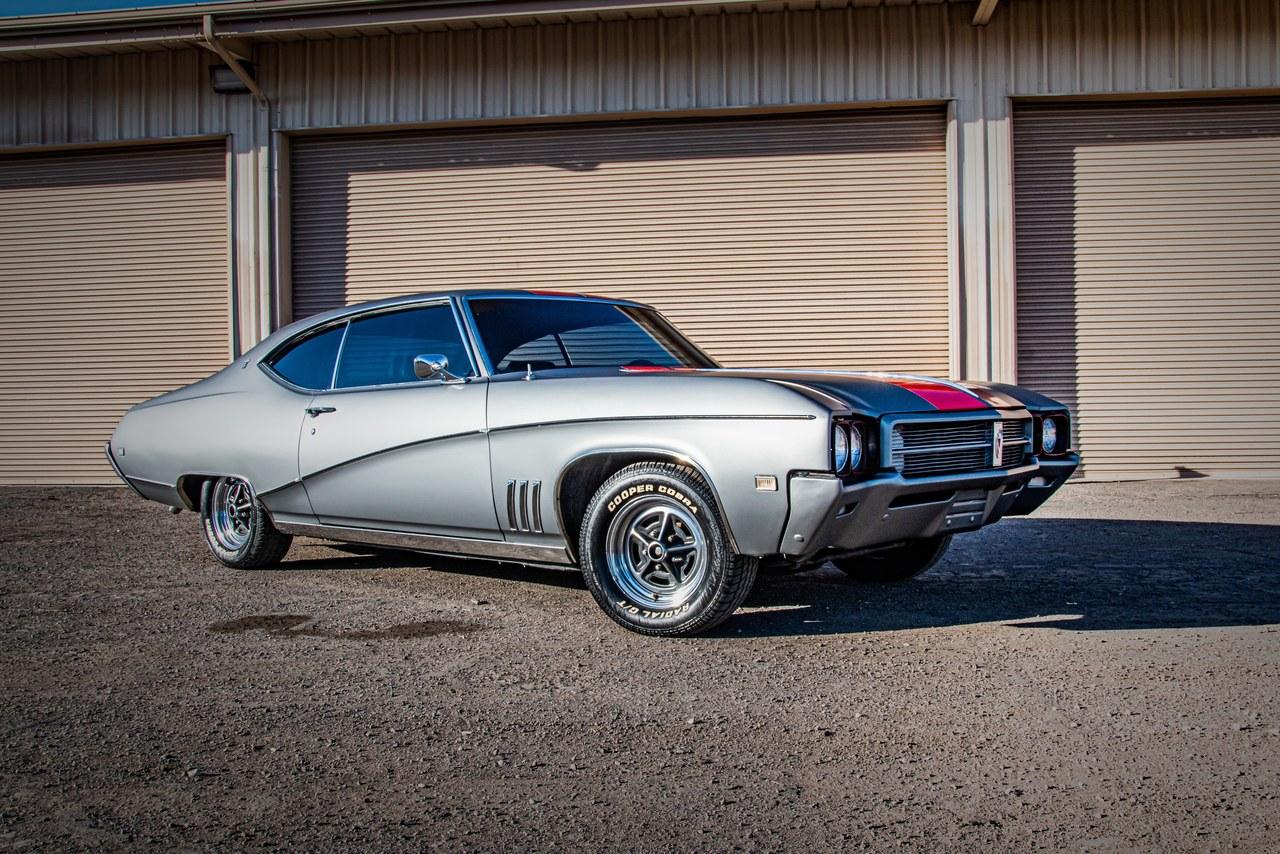 1969 buick skylark side view in front of garage
