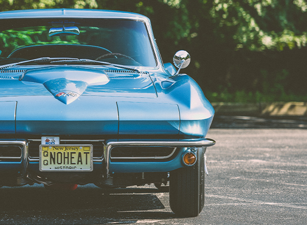 front facing blue chevy corvette